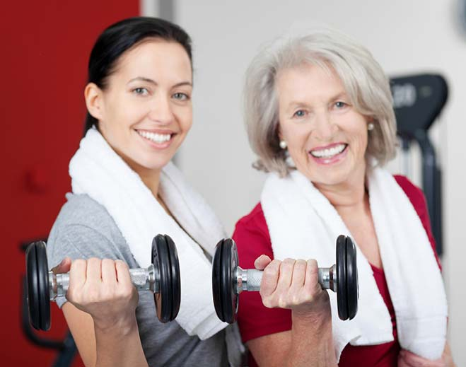 two ladies holding weights