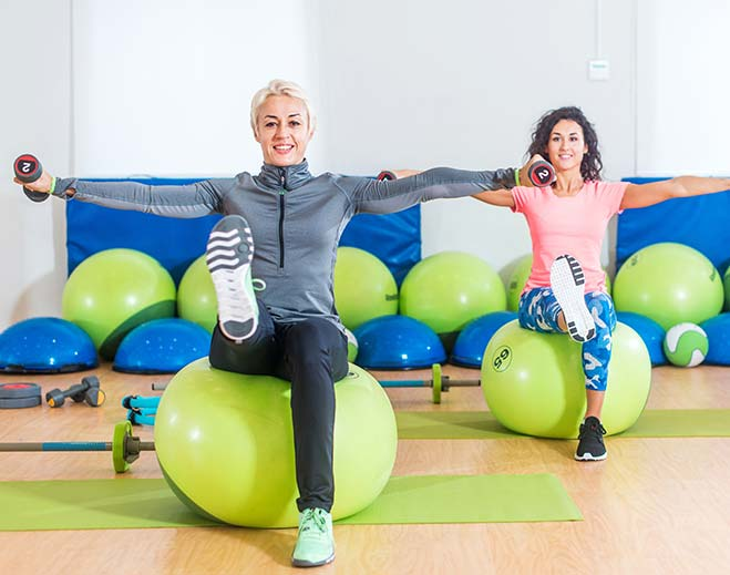 women on exercise balls